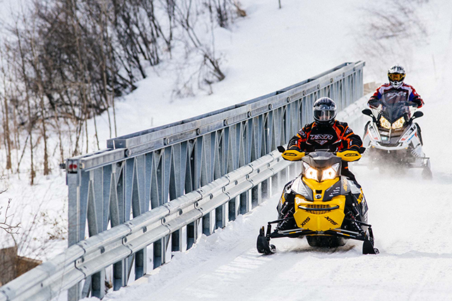 cool dudes on snowmobiles