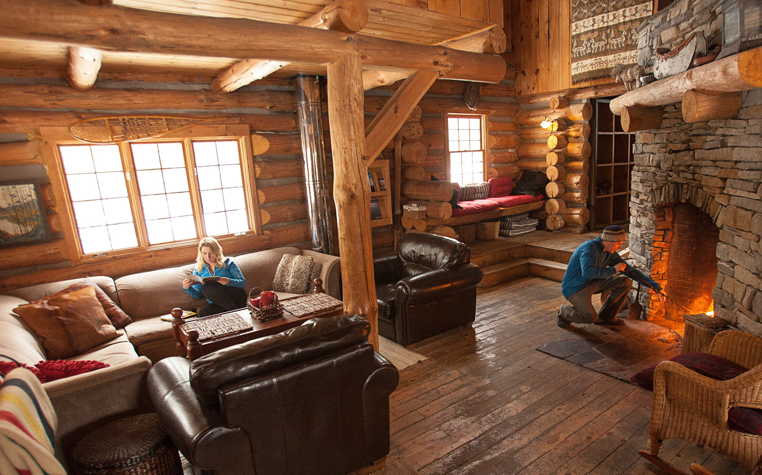Young couple relaxing in a cozy log cabin