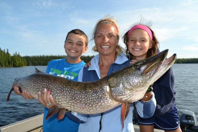 The Malek Family proudly holds their northern pike