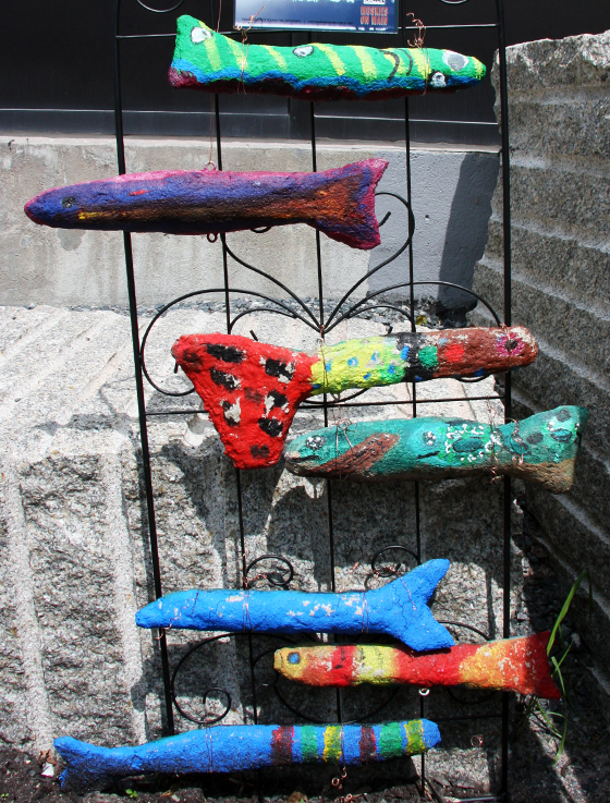 Young artists made these muskies from using rolled paper, tape, webbing and concrete.