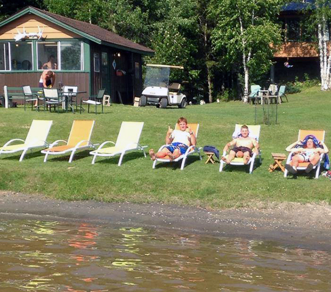 Relax and take in the sun waterside at Bonny Bay Camp