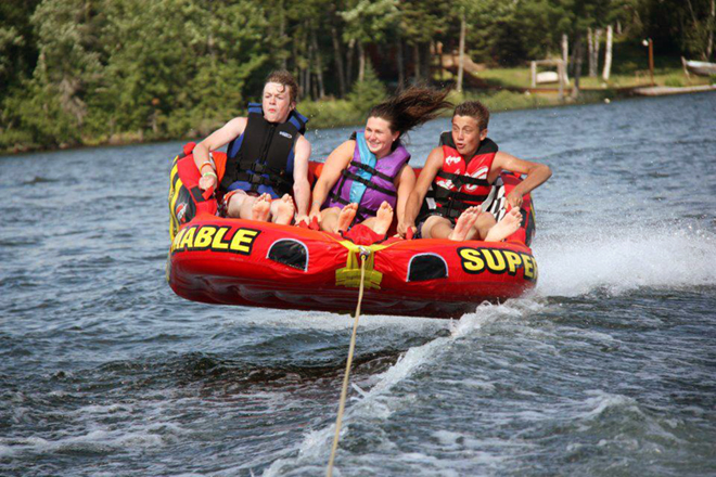 Tubing on Clearwater Lake at True North Outpost & Cabins