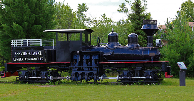 Shevlin-Clark Timber Display Train onthe Centennial Museum grounds
