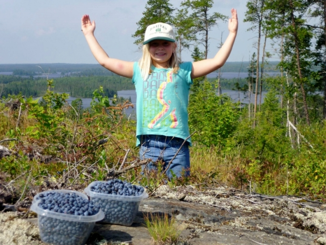 "Kylie Kesanen shows off her bounty picked near <a href=""http://timberwolflodge.org/"">Timber Wolf Lodge</a>"