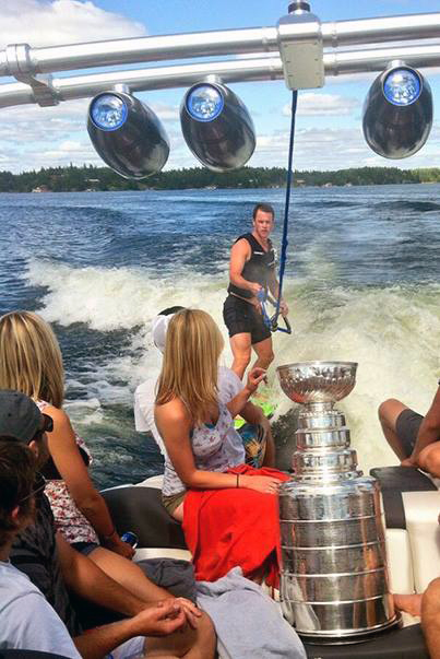 Jonathon Toews takes the Stanley Cup out for a day on Lake of the Woods