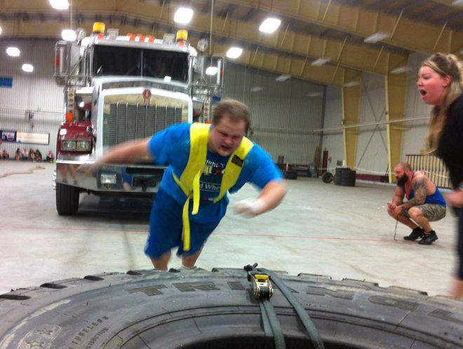 Contestant at the Weights and Wheels pulling a semi! Thanks to CKDR for the photo.