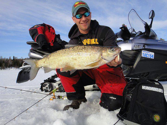 Jeff Gustafson with a big Lake of the Woods whitefish