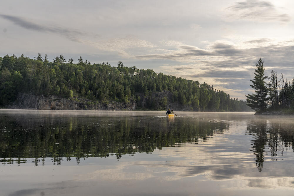 A lifting mist on Hamburg Lake, Quetico. Plan your own magical trip with the help of an experienced outfitter. Photo: David Jackson