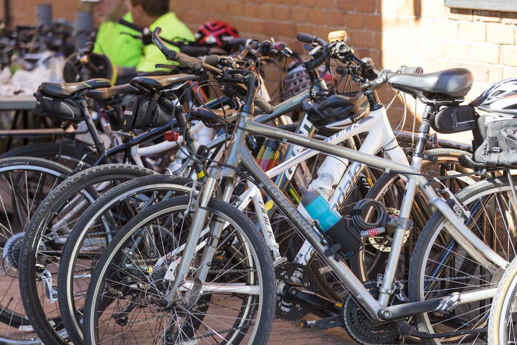 A bunch of bicycles in a bicycle rack.