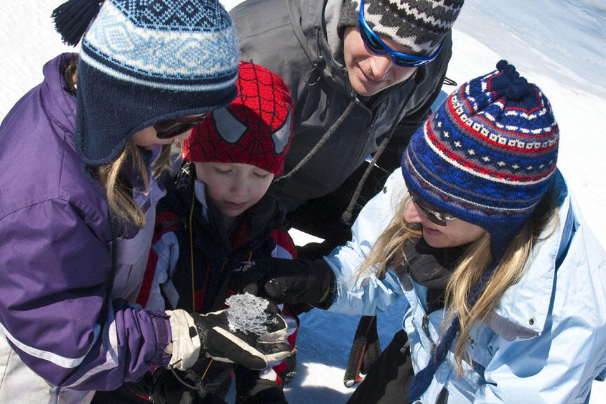 Kids looking at an ice crystal.