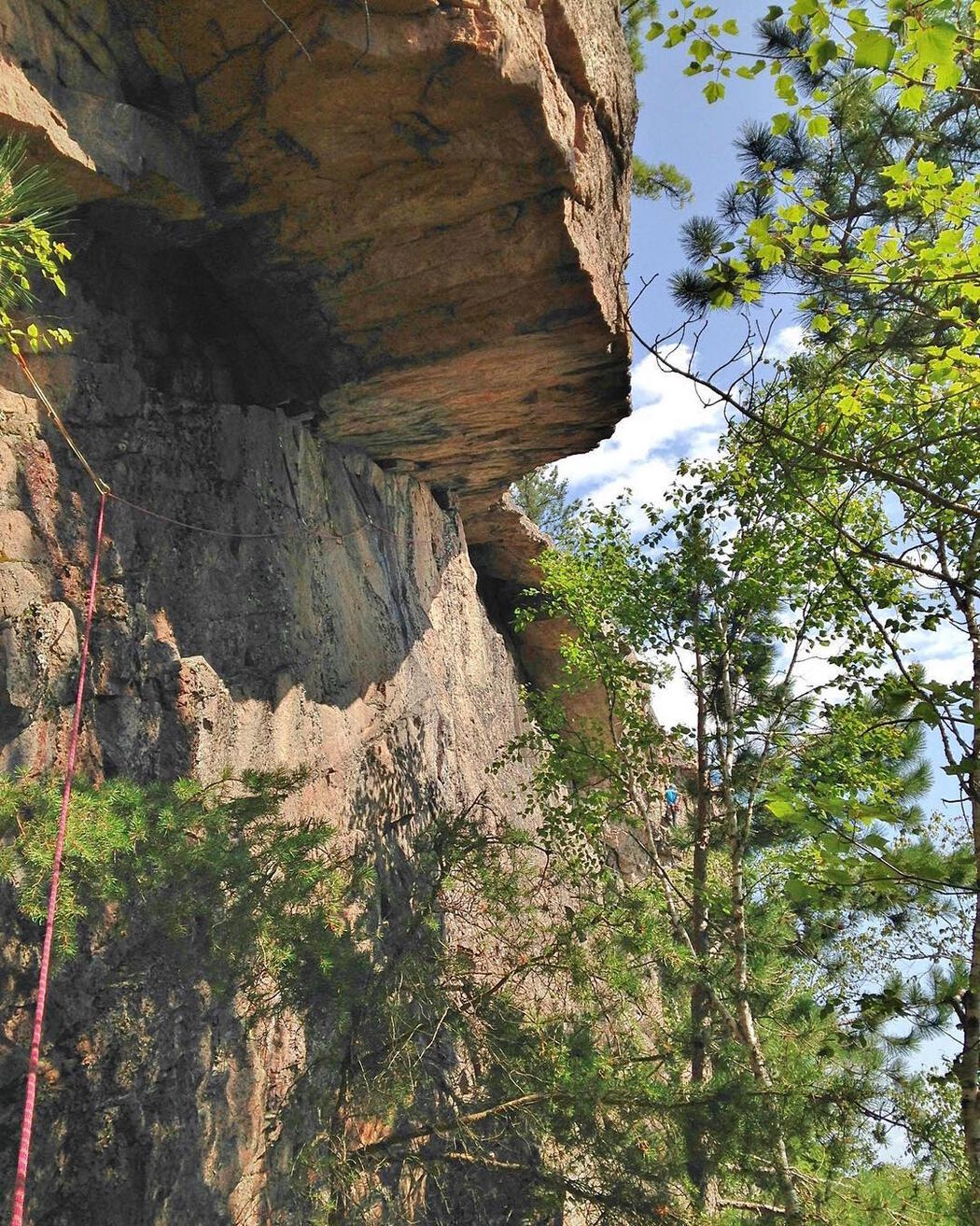 Looking up at a tall rock face.