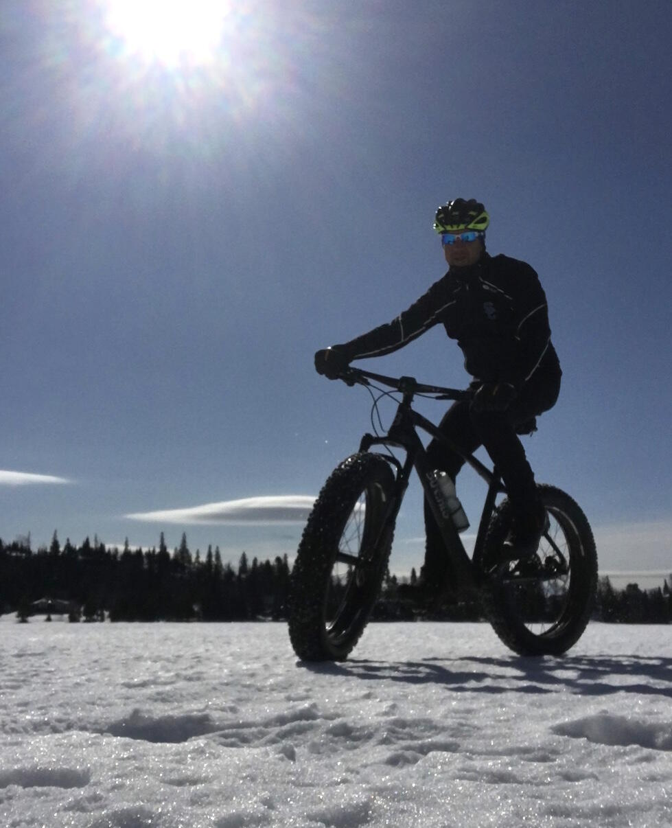 Man on a fat bike riding on the snow.