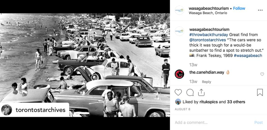 Archive photo from 1969 shows lots of cars and people on the beach.