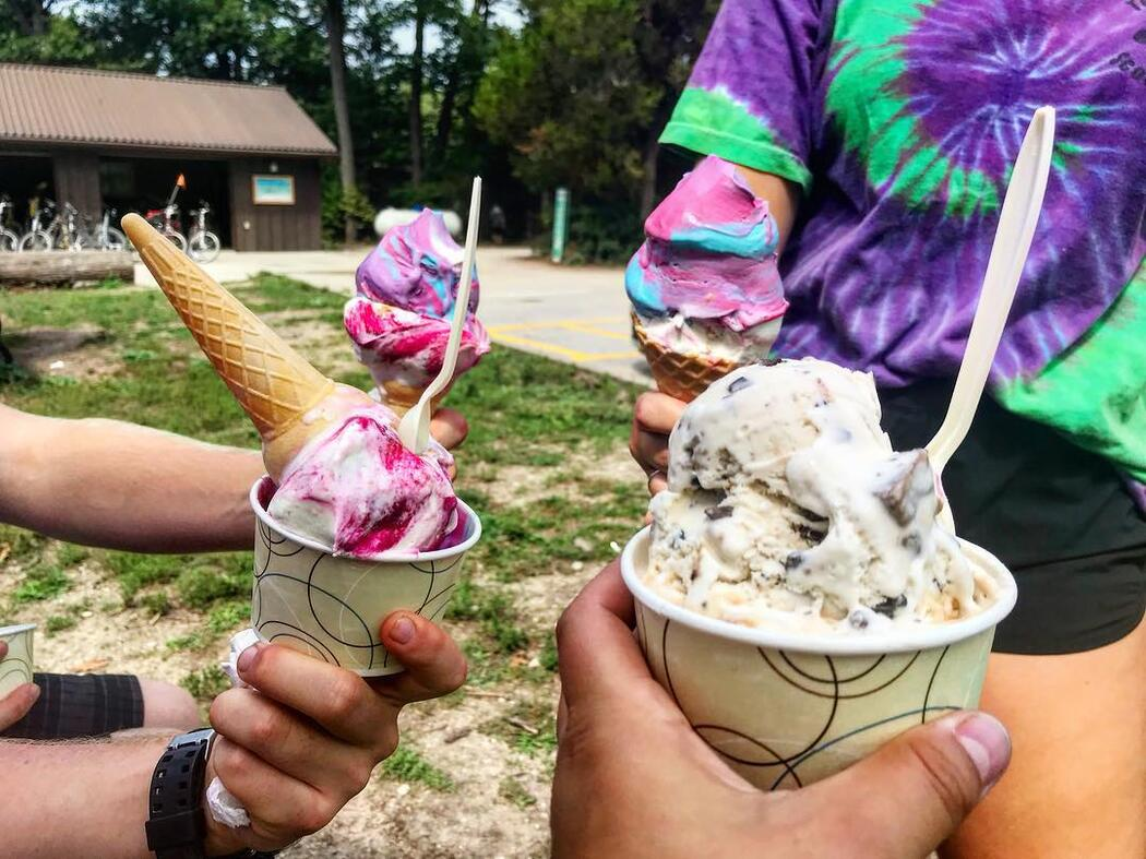 Four people holding ice cream treats.