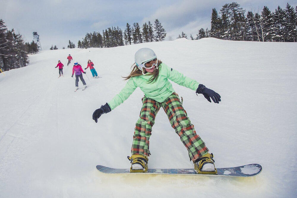 Young girl on snowboard.