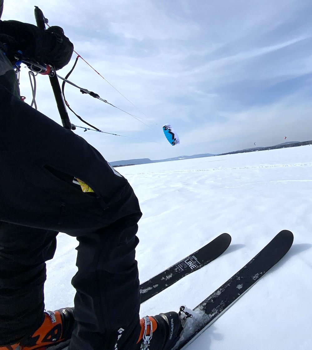 Close up of person holding a control bar for snowkite.