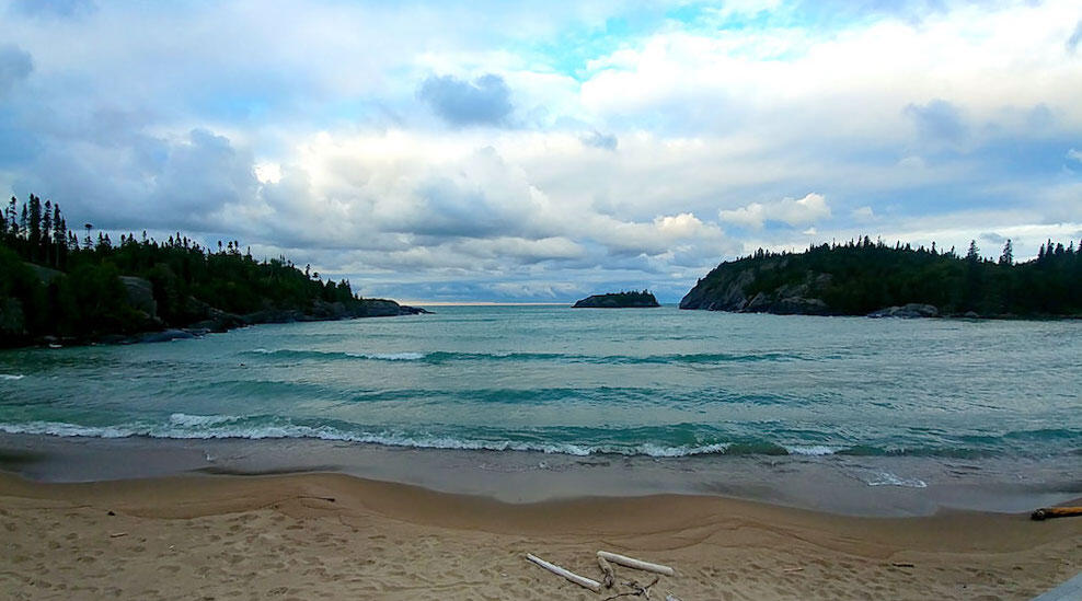 Sandy beach with turquoise water and waves