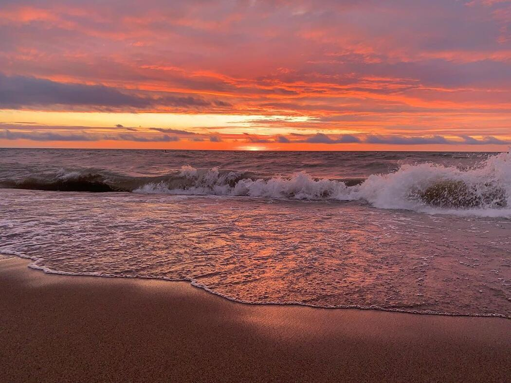 Beautiful sunset over rolling waves.