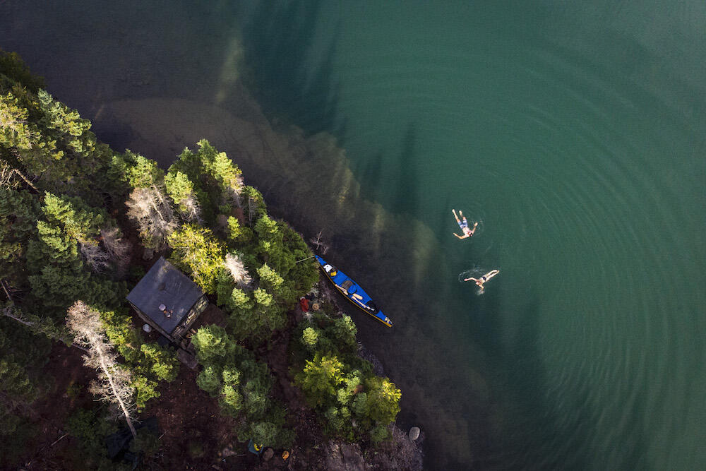 Overhead shot of people floating in the water.