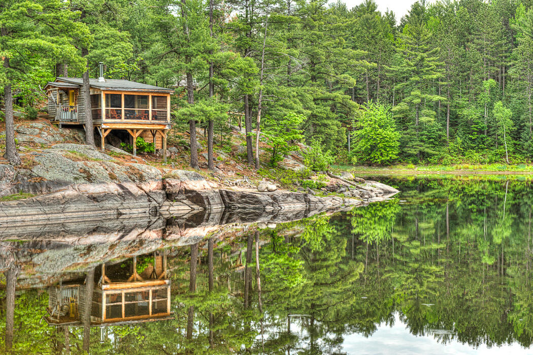 Beautiful cabin perched on shoreline of French River.