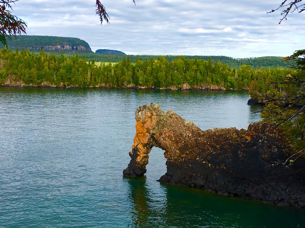 A interesting rock formation on a lake.