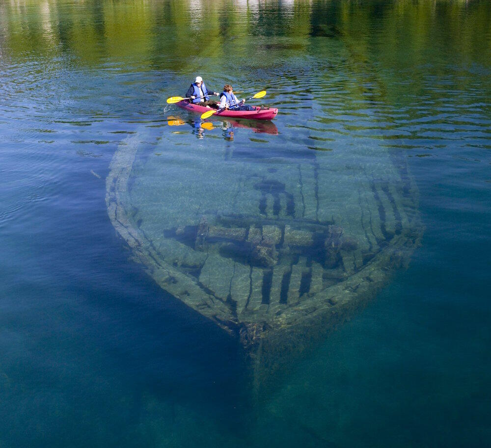 A kayak travelling over a submerged shipwreck