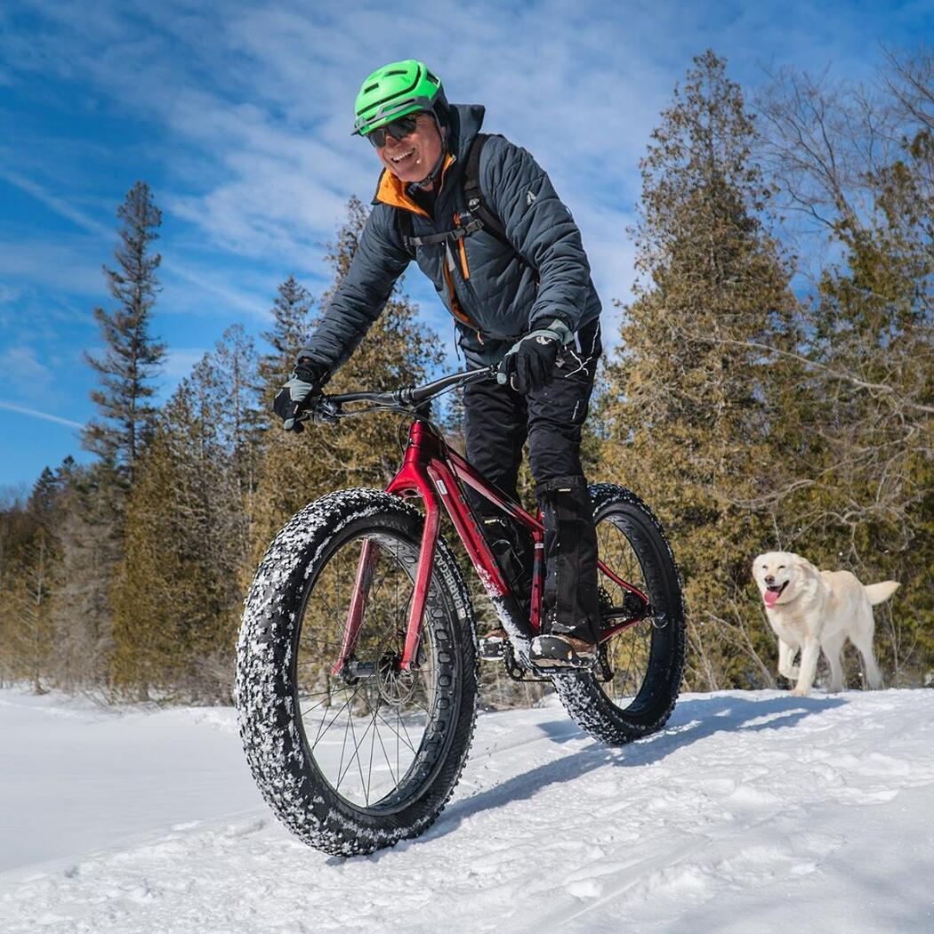 Man riding a fat bike in snow.
