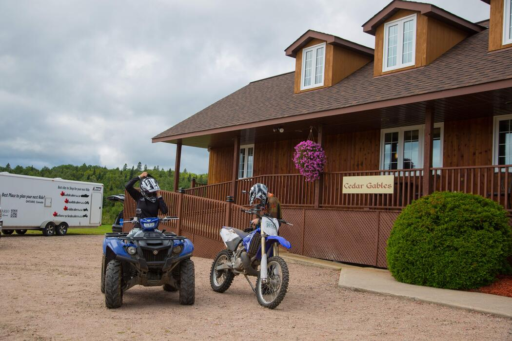 Miesha Tate and Bryan Caraway suiting up for a ride at Cedar Gables Lodge in North Bay, Ontario
