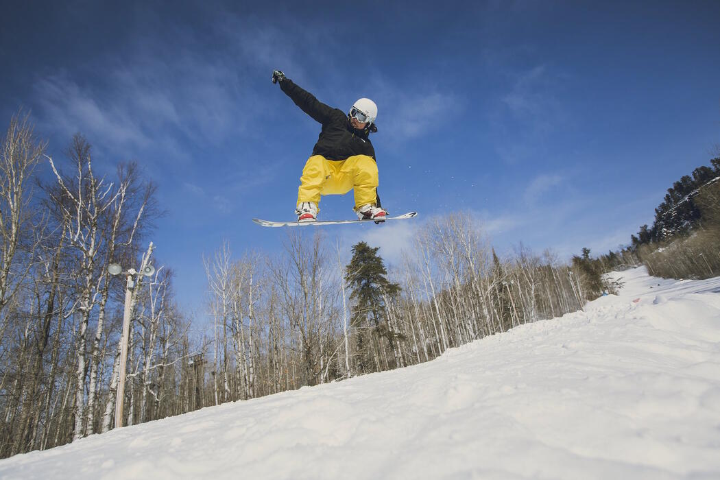 Person on a snowboard catching air.