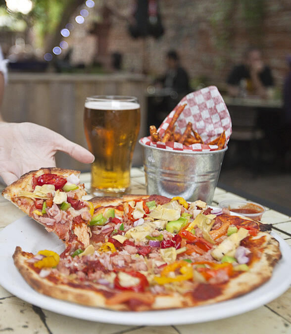 Pizza and a glass of beer.