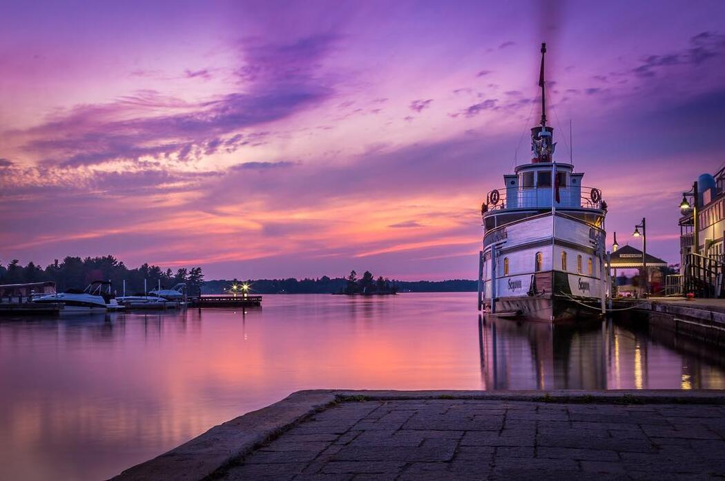 RMS Segwun ship at Gravenhurst wharf at sunset.