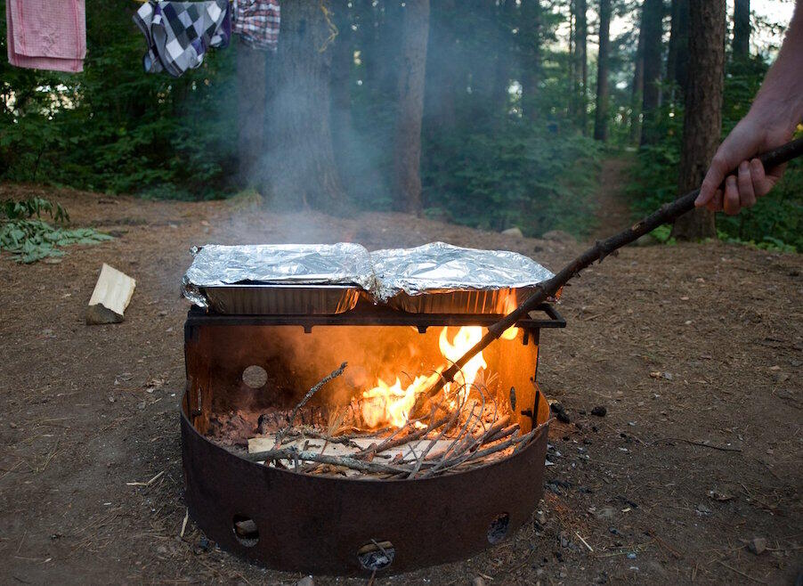 Campfire in campfire metal ring with grill on top