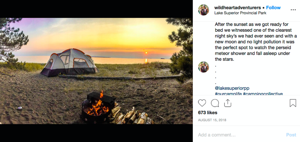 Instagram post of tent on beach in front of sunset