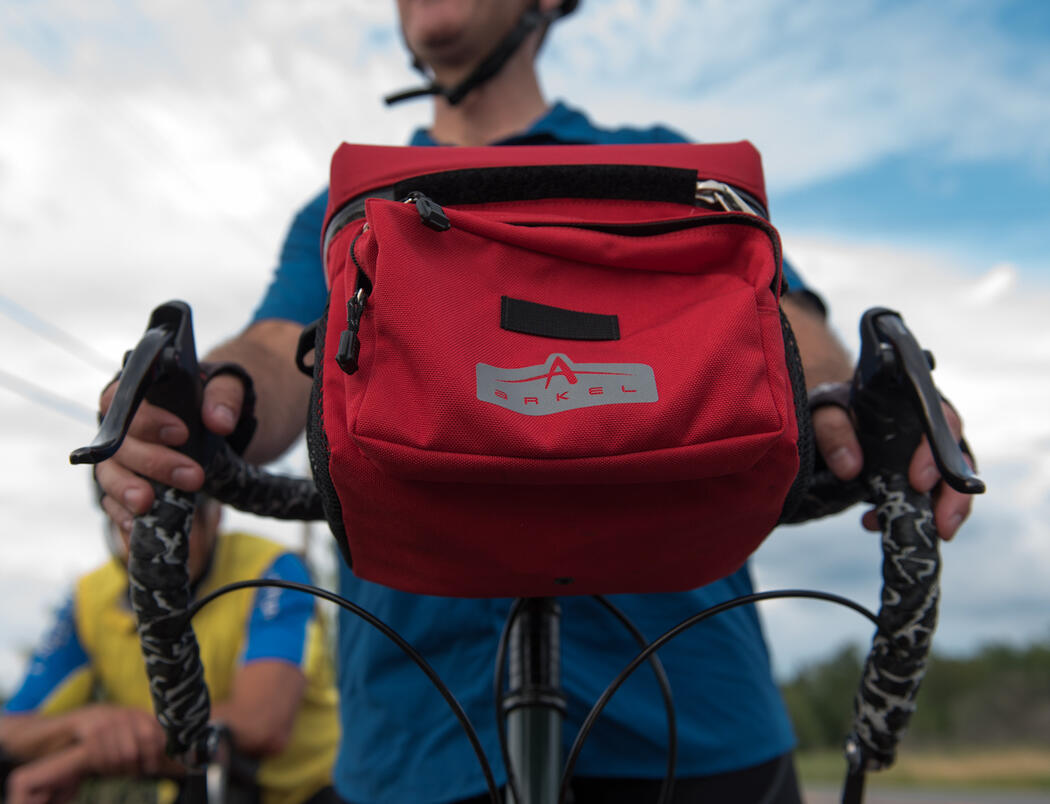 Red bicycle pack on front handle bars.