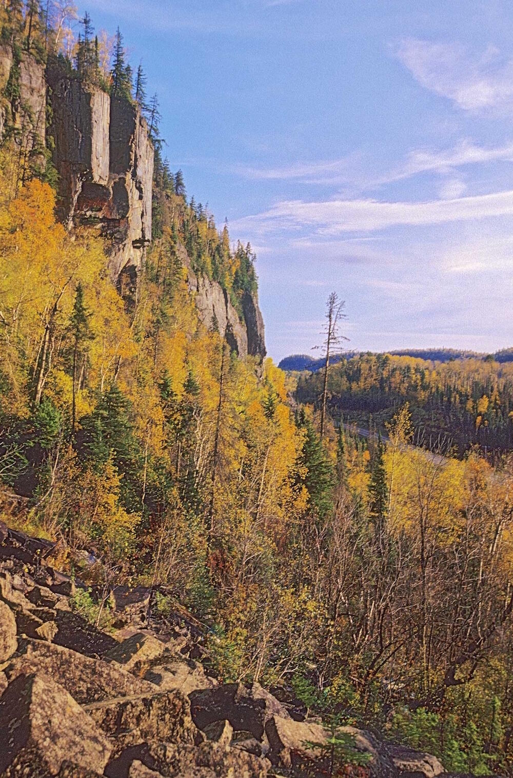 Majestic rock cliffs with boreal forest in fall.