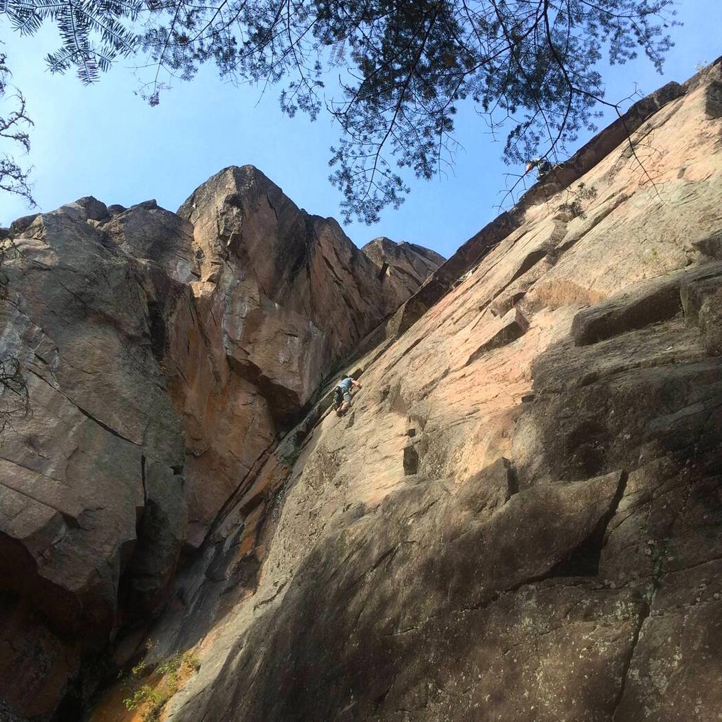 Looking up at a rock face.