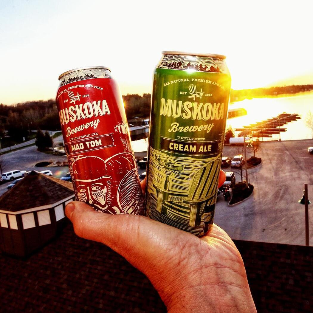 Two cans of Muskoka Brewery beer