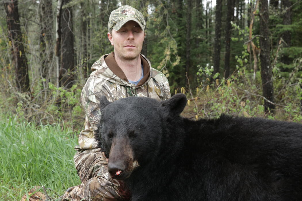 hunter with ontario black bear