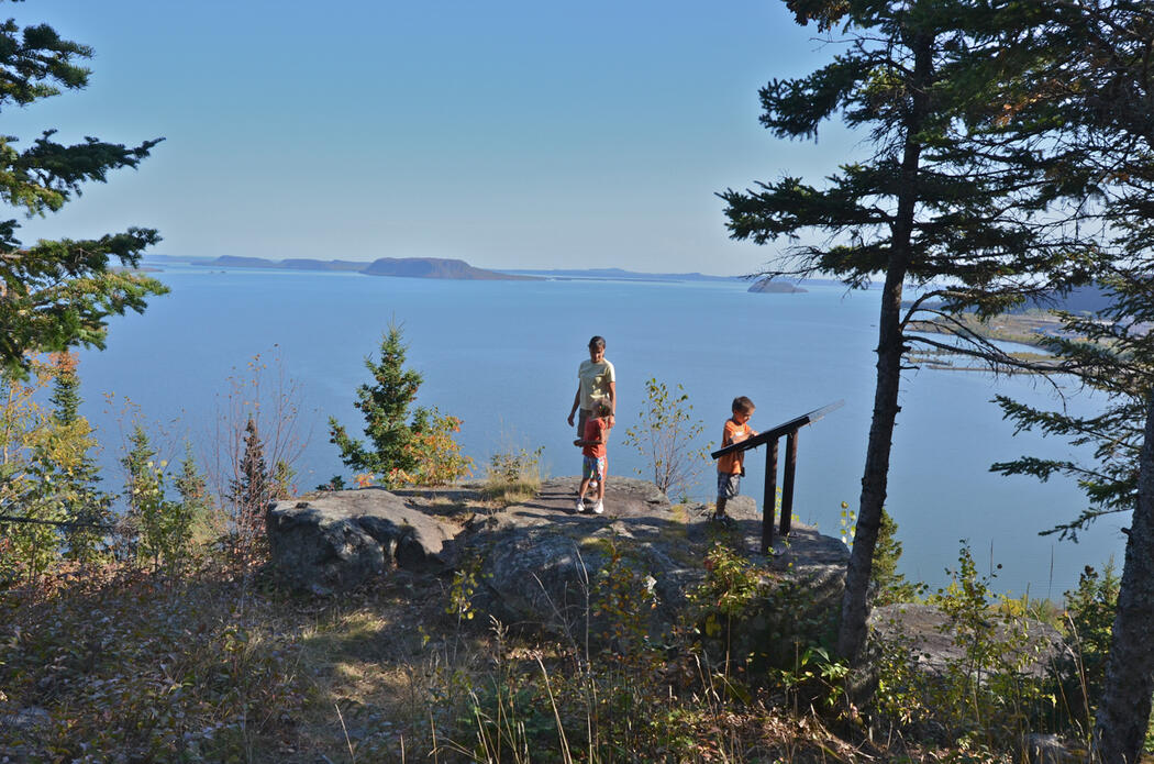 Woman and two children on scenic lookout overlooking Lake Superior
