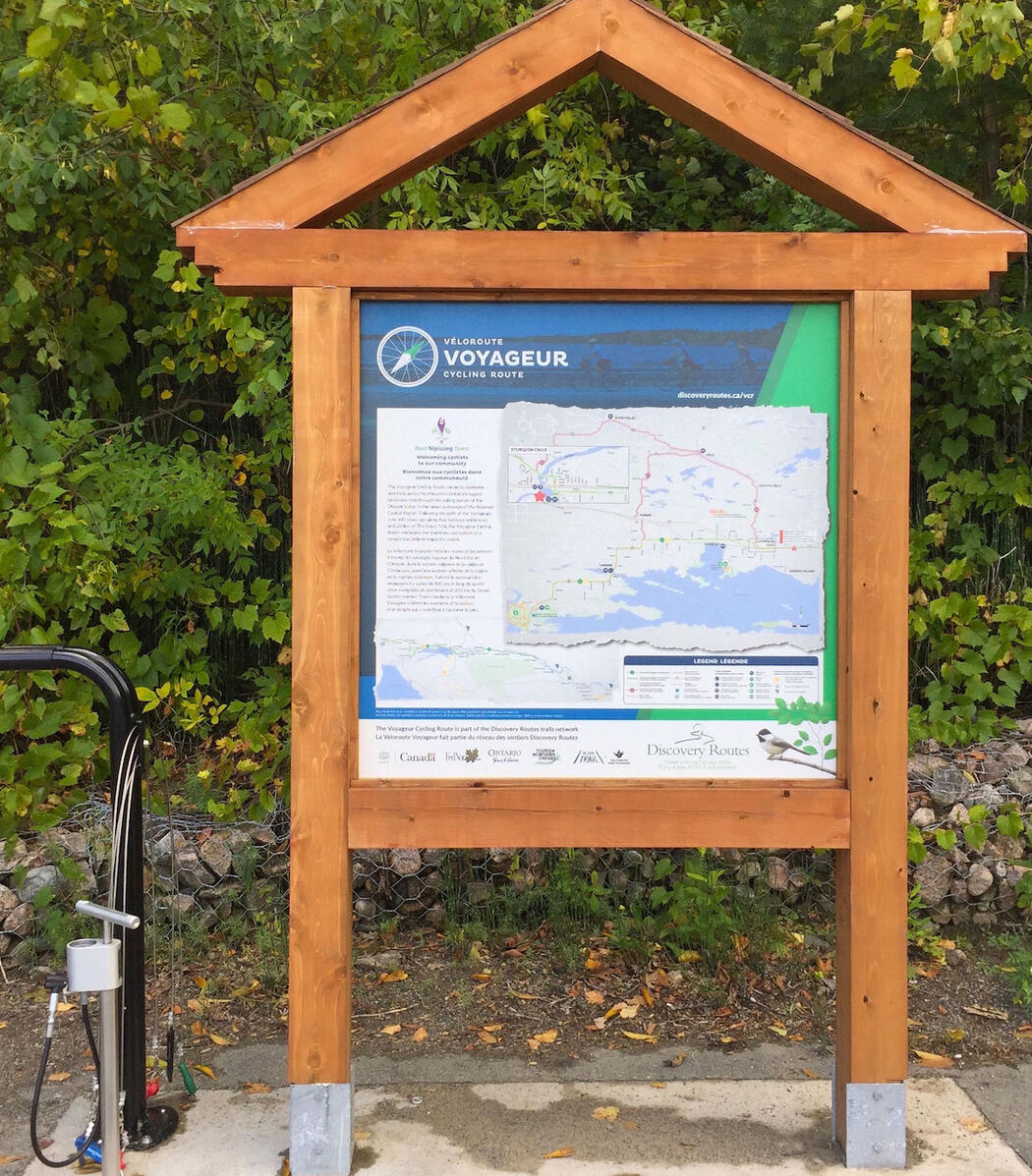 Information kiosk with map of Voyageur Cycle Route and bicycle air pump