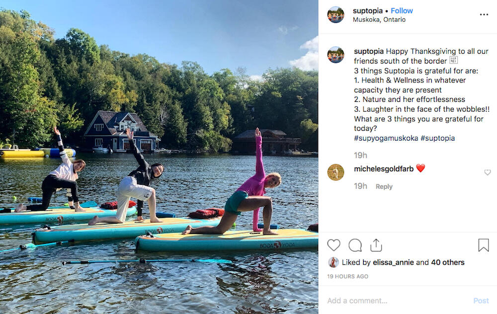 Instagram post showing several people doing yoga on standup paddleboards.