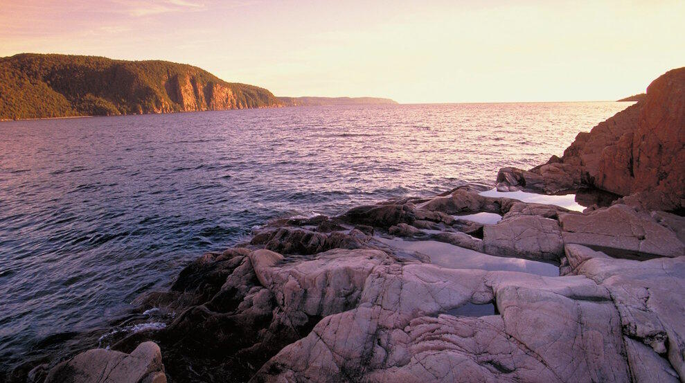 View of Lake Superior at sunrise with steep rocky cliffs
