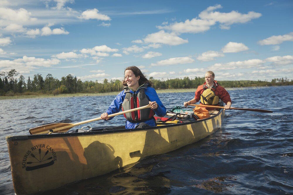Two people paddling a lightweight canoe
