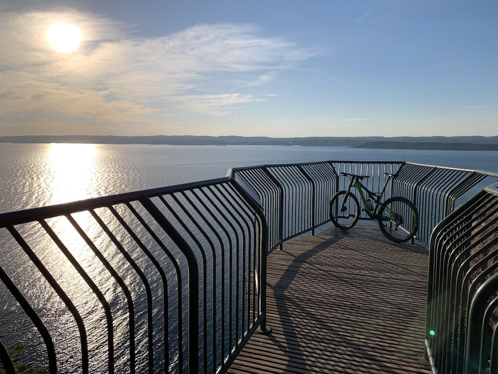 Bicycle parked on a wooden lookout overlooking Lake Superior.