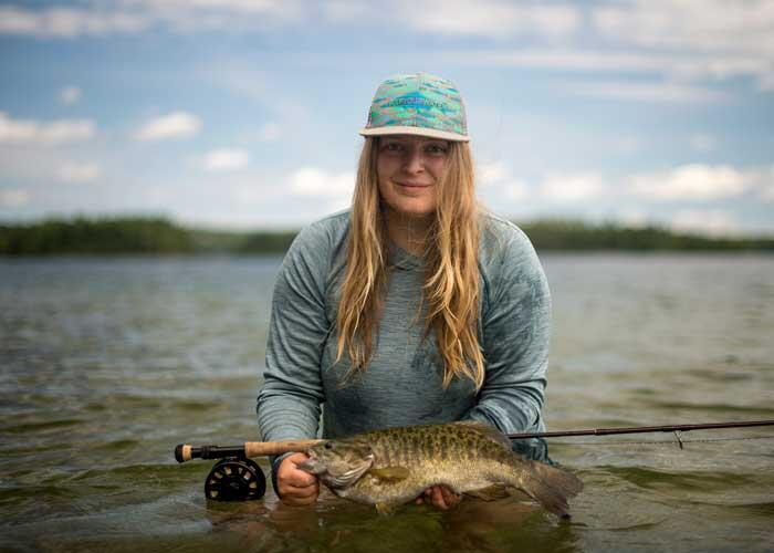 woman angler with smallmouth bass