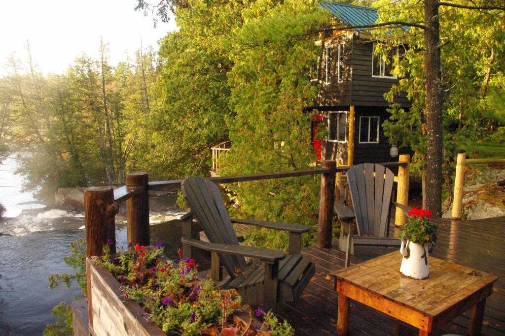 Deck and cabin overlooking a waterfalls