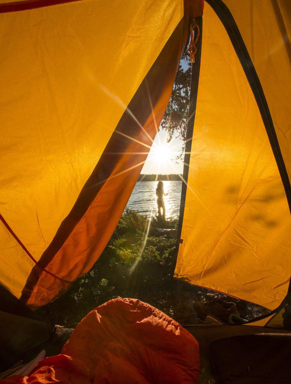 View of lake from inside of a tent