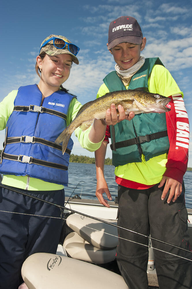 young anglers holding walleye