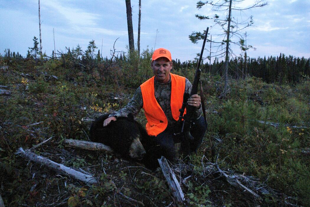 hunter with harvested black bear