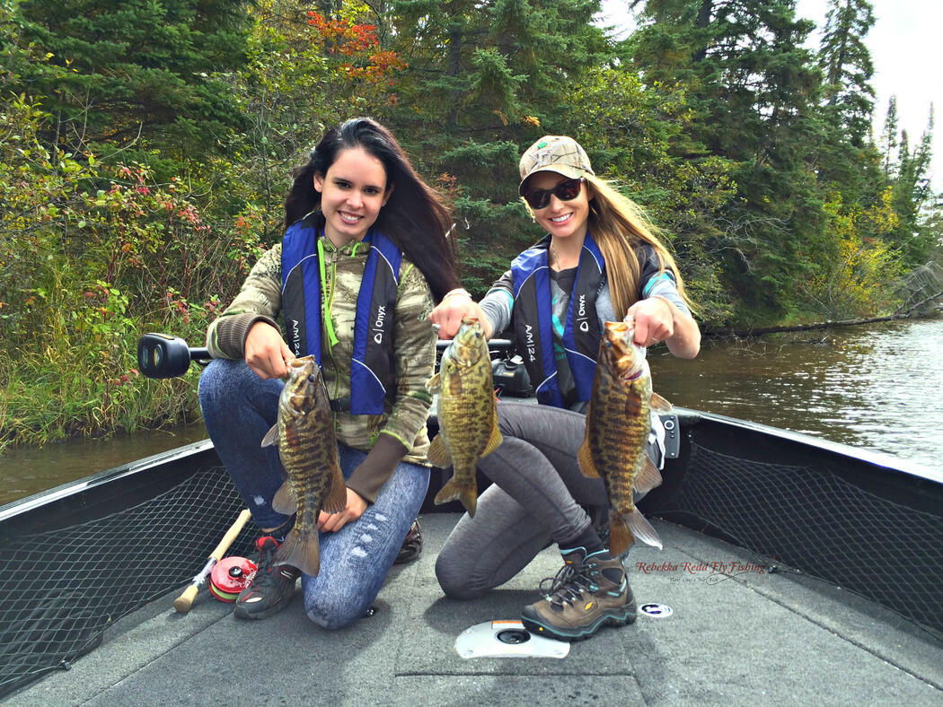 women anglers with bass